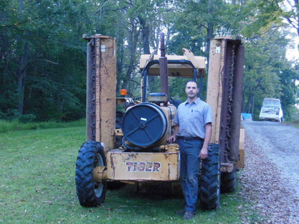 Company president, Todd Kudas, with the finished tractor.