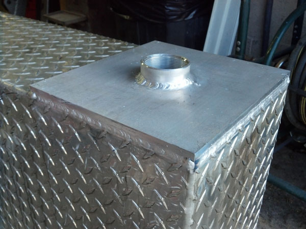 Repaired Fuel Tank With Aluminum Plate and Threaded Port.